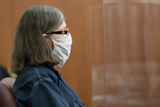 Dana Chandler listens during a pre-trial hearing on the admissibility of evidence as part of her retrial for the 2002 killings of Mike Sisco and Karen Harkness.