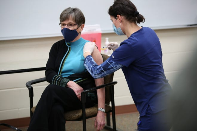 Gov. Laura Kelly receives the Moderna COVID-19 vaccine in December. The state will move into Phase 2 of COVID-19 vaccine distribution Thursday, her office said. [December file photo/The Capital-Journal]