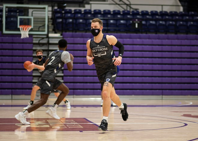 Holy Cross senior guard Austin Butler works out at practice earlier this week.