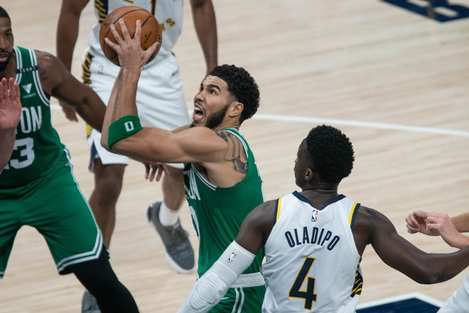 Celtics forward Jayson Tatum shoots the ball against Pacers guard Victor Oladipo during the second quarter Tuesday night.