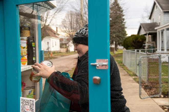 "Sarah Grim places non-perishable foods and other necessities inside a blessing box, that she requested be placed outside of her home in Columbus. ""If I had a million dollars, I could fill this box two maybe three times a day,"" Grim said. ""As long as they're taking it, I'll keep filling it,"" she added with a smile."