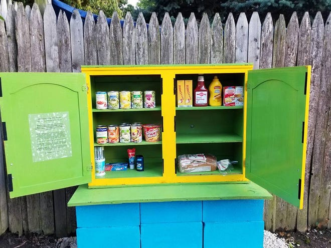 "This brightly-colored ""Blessing Box"" has been at Ann and Sycamore streets near German Villlage in Columbus, Ohio,  for about five years. Owner Michael Uetrecht stocks it with freshly made ham and turkey and cheese sandwiches on the weekend."