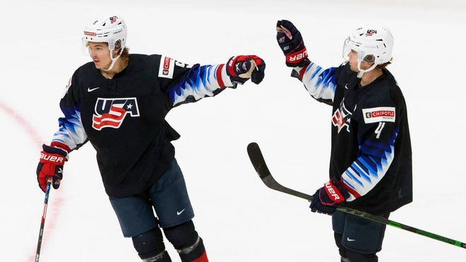 The United States' Trevor Zegras, left, and Cam York celebrate a goal against the Czech Republic during the third period Tuesday.