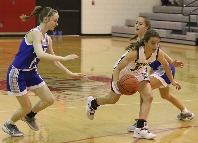 Dover's Addie Martin drives through a Tuslaw double team against Kasi Tully and Selah Yost Wednesday afternoon.
