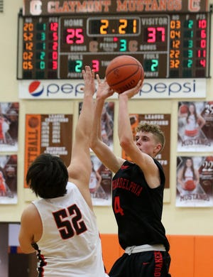 New Philadelphia's Michael Vickers shoots as Claymont's Gavin Povick defends Tuesday at Claymont.
