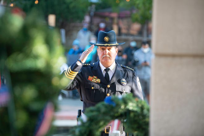 Pueblo County Sheriff Kirk Taylor salutes the 9/11 memorial at the Center for American Values on Friday  September 11 at the conclusion of the remembrance event.