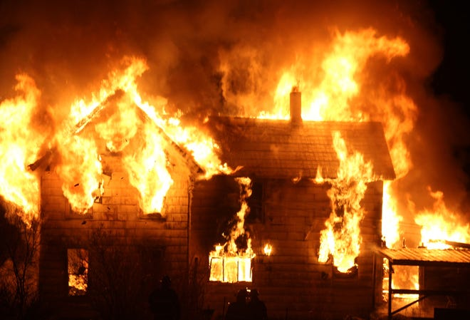 Firefighters battle a structure fire at 2225 Rt. 417 in the Town of Andover Wednesday night.