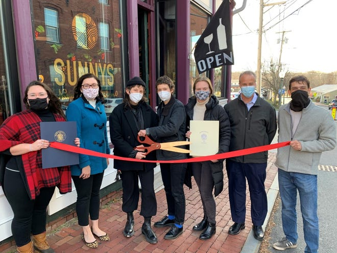 SUNNYS is a natural wine store that recently opened in downtown Amesbury. Shown here, left to right, are Calee Merenda, Legislative Aide to State Representative Diana DiZoglio; Amesbury Mayor Kassandra Gove; Laura Poladsky, co-owner of SUNNYS; Caitlin Frame, co-owner of SUNNYS; Courtney Ryan, Legislative Aide to State Representative James Kelcourse; Matt Sherrill, owner of Gould Insurance and member of the Amesbury Chamber of Commerce's Board of Directors; Phil DeCologero, Executive Director of the Amesbury Chamber of Commerce.