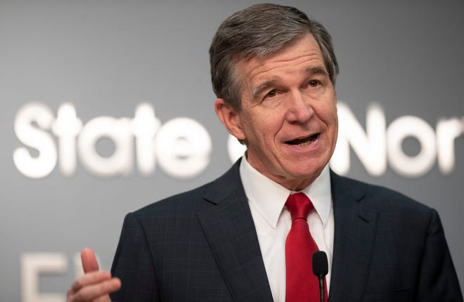 "FILE - North Carolina Gov. Roy Cooper speaks during a press briefing Dec. 30, 2020, in Raleigh, N.C. Cooper with others recently unveiled ""guiding principles"" for revamping health care in the state.(Robert Willett/The News & Observer via AP)"
