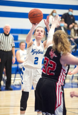 Wynford's Kaylee Smith attempts a basket.