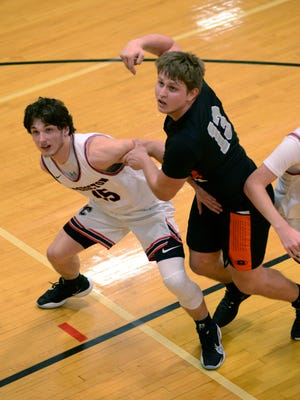 Coshocton's Korbyn Haley, left, and Ridgewood's Kadin Bradford fight for rebounding position during a regular season matchup at The Wigwam. Ridgewood won, 51-48, and the two could meet again in the postseason.