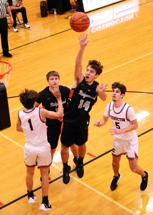Dalton Patterson, of Ridgewood, shots in the lane against Coshocton earlier this season. Patterson was tabbed the All-Tribuneland Boys Basketball Player of the Year.