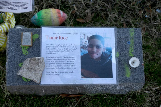 In this Dec. 13 photo a memorial for Tamir Rice is seen at the base of the Gen. Robert E. Lee statue is seen Dec. 13 in Richmond, Va.