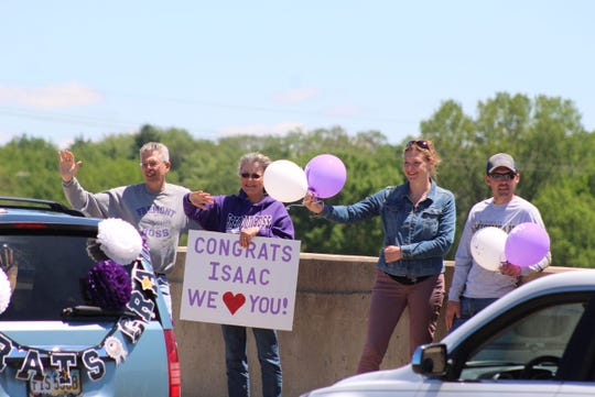 City residents cheered on Fremont Ross High School's 2020 graduates in June from the State Street bridge, as the high school celebrated commencement with a parade through the city.