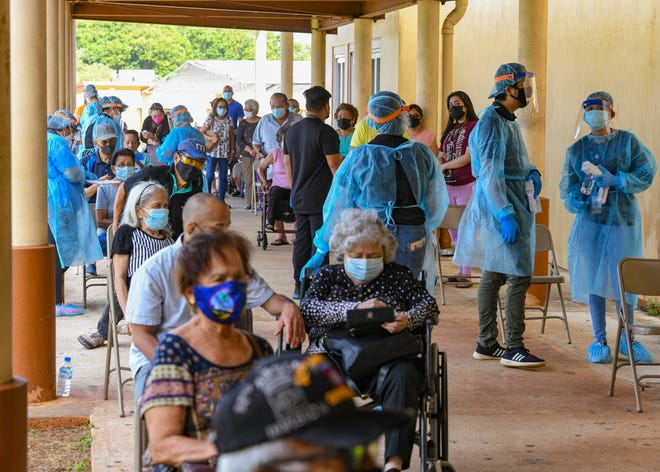 Hundreds of Guam's manåmko', or elderly, community and those accompanying them, attend the third day for the administering of the Pfizer-BioNTech COVID-19 vaccine to the seniors during a temporary vaccination clinic conducted by the Department of Public Health and Social Services at Okkodo High School in Dededo on Dec. 30, 2020.