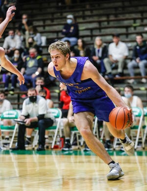 Fort Wayne Blackhawk Christian Braves' Caleb Furst (3) drives to the hoop during the Raymond James Hall of Fame Classic Tournament at the New Castle High School Fieldhouse in New Castle Ind., on Wednesday, Dec. 30, 2020.
