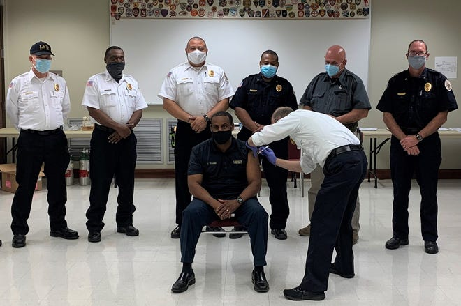 Lafayette Fire Department Public Information Officer Alton Trahan receives the Moderna COVID-19 vaccine.