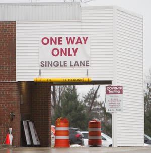 The drive-through COVID-19 testing site at St. Joseph Mercy Livingston Hospital has no cars waiting the afternoon of Wednesday, Dec. 30, 2020.