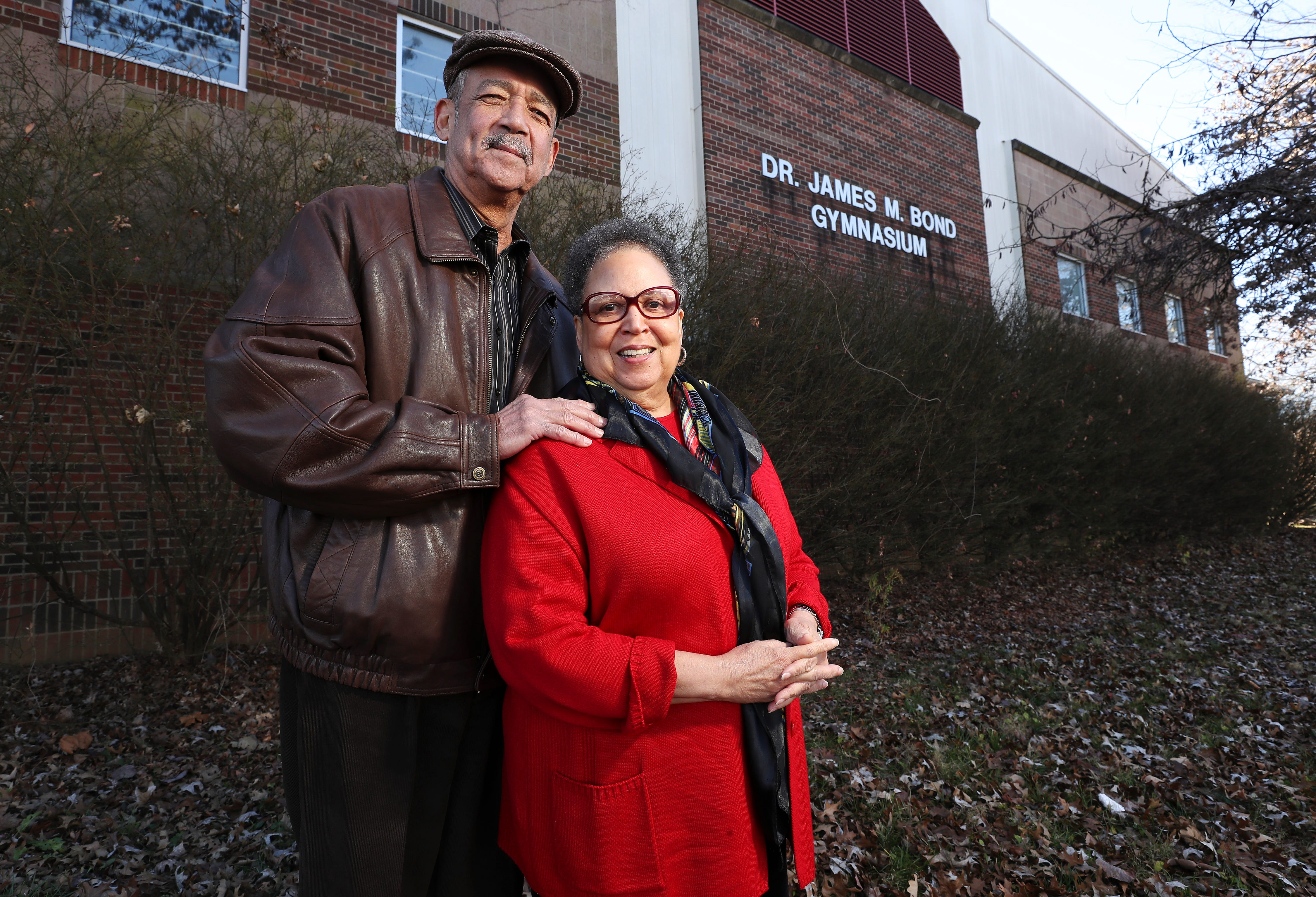 Former educator Deanna Shobe Tinsley, right, and her husband Max Tinsley in front of the Dr. James M. Bond Gymnasium at Byck Elementary School in west Louisville. The gym is named for Max's grandfather. Dec. 22, 2020
