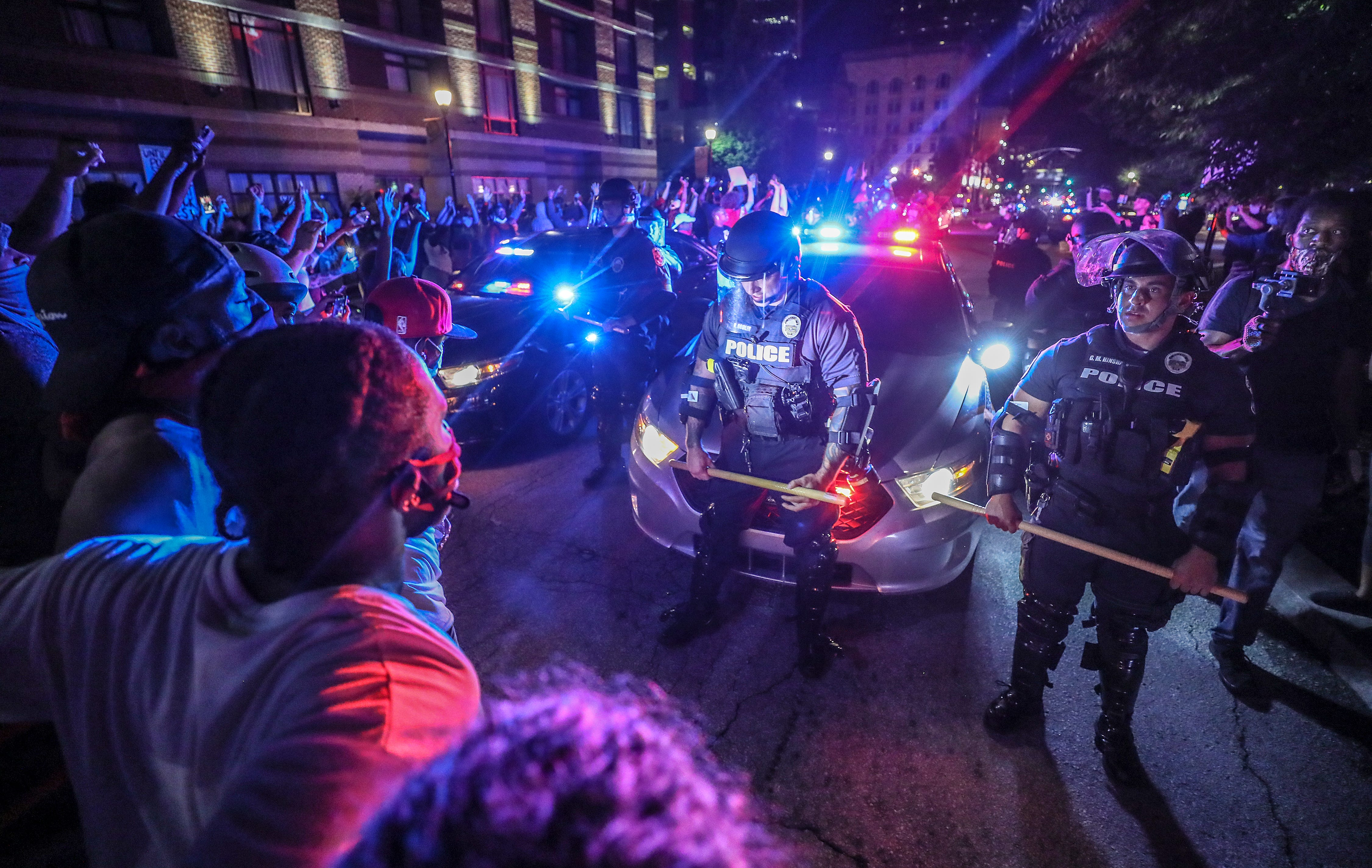 Police move protesters back as they tried to move their patrol cars west on Main Street in front of the KFC Yum! Center on Thursday, May 28, 2020