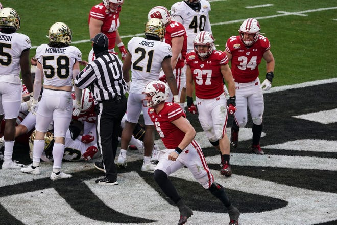 Badgers quarterback Graham Mertz celebrates one of his two rushing touchdowns Wednesday.