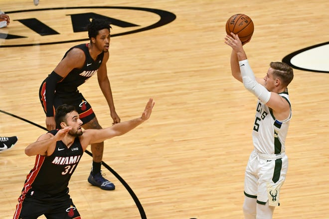Rookie forward Sam Merrill puts up and hits the Bucks' 28th three-pointer of the game against the Heat which broke NBA record for threes in a contest.