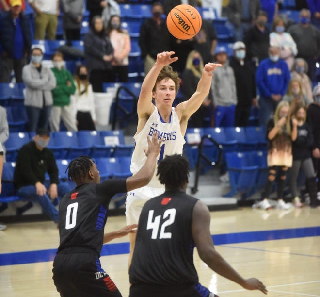 Mountain Home's Reed Ellison passes during the Bombers' 52-40 loss to West Memphis on Tuesday night.