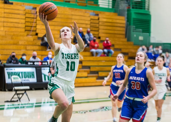 FILE -- Yorktown's Carley Culberson shoots past Jay County's defense during their game at Yorktown High School Tuesday, Dec. 29, 2020.