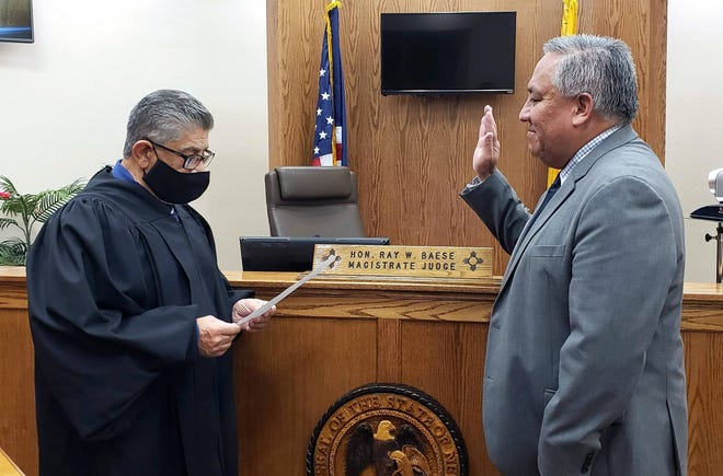 At right, Michael Renteria (D-Deming) is sworn in and takes the oath of office as the District Attorney for the New Mexico Sixth Judicial District. Renteria was elected in November and will serve the tri-county area (Luna, Hidalgo and Grant). He was sworn-in byLuna County Magistrate Court Judge Ray Baese at left. There are only 13 district attorneys in New Mexico making it one of the most important positions in the state.
