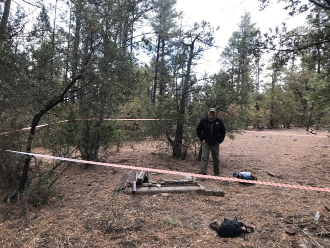 A safety hazard along the Pueblo Park Interpretive Trail (Trail to the Past) was discovered Tuesday and hikers are asked to exercise extreme caution. A U.S. Forest Service employee is pictured near the hazard, surrounded by flagging.