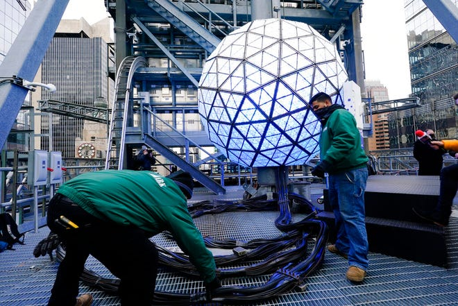 Event organizers test the New Year's Eve Ball ahead of the official Times Square celebration Wednesday, Dec. 30, 2020, in New York. (AP Photo/Frank Franklin II)