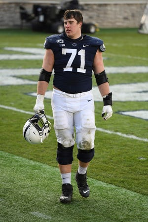 Penn State offensive lineman Will Fries (71) leaves the field following an NCAA college football game against Michigan State in State College, Pa., on Saturday, Dec. 12, 2020. (AP Photo/Barry Reeger)