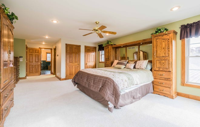 The master bedroom provides plenty of space to create a reading nook or a place for simply relaxing.