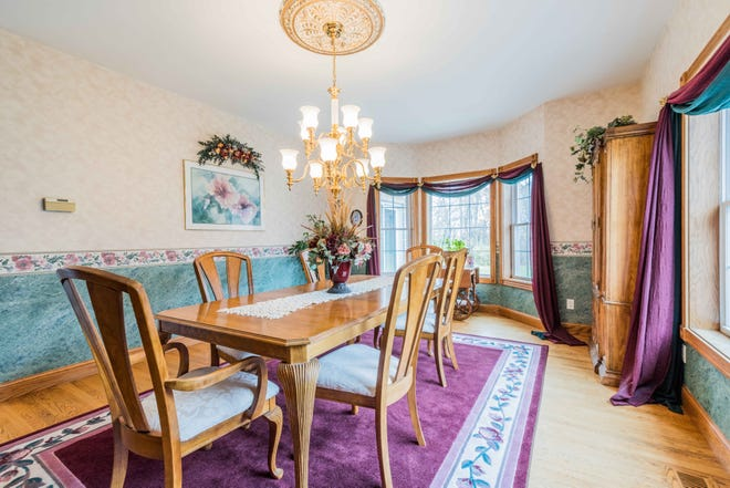 The formal dining room provides plenty of space for hosting dinner parties.