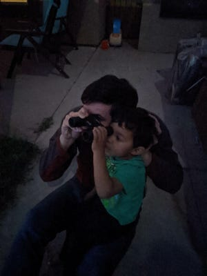 """Candace's grandson, Martin, shares binoculars with his daddy to see the """"Christmas Star."""""""