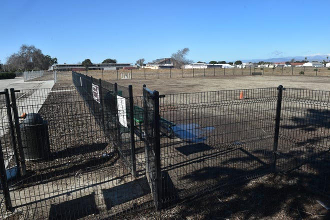 A dog park sits on one corner of an undeveloped property known as Campus Park on Tuesday, Dec. 29, 2020. The city of Oxnard plans to develop the park with funds from a state grant. The long vacant property is the former site of Oxnard High School.