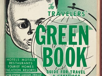 "This updated photo courtesy of the Schomburg Center for Research in Black Culture, part of the New York Public Library, shows an undated copy of ""The Travelers' Green Book"" from 1960. Black travelers for decades needed a guide known as the Green Book to help located the few motels and restaurants that would serve them. Now a writer is hoping to bring attention to the businesses along the historic Route 66 that once provided safe havens for black travelers who braved the road for simple family vacations."