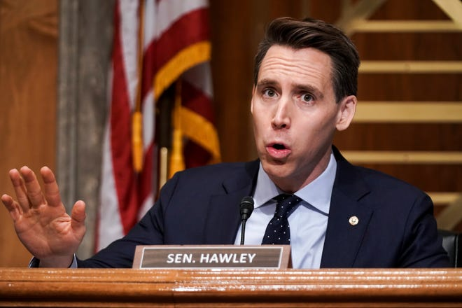 Sen. Josh Hawley, R-Mo., asks questions during a Senate Homeland Security & Governmental Affairs Committee hearing to discuss election security and the 2020 election process on Wednesday, Dec. 16, 2020, on Capitol Hill in Washington, D.C..