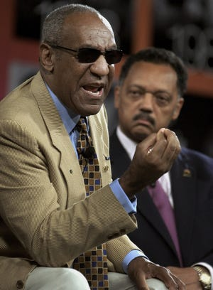 In this 2004 file photo, Bill Cosby and Jesse Jackson attend an annual conference for civil rights organization Rainbow Push Coalition.