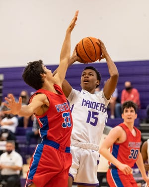 Jayden Thompson takes a shot for Cedar Ridge while defended by Westlake's Diego Schleppe. Westlake won a boys nondistrict basketball game at Cedar Ridge 81-52 on Dec. 30.