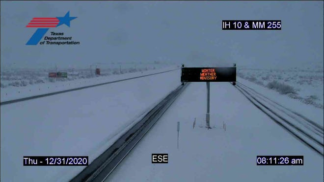 Interstate 10 at Fort Stockton appears covered in snow in this shot from a Texas Department of Transportation road camera on Thursday morning. Large swaths of West and Central Texas are under a winter storm warning until midnight Friday.