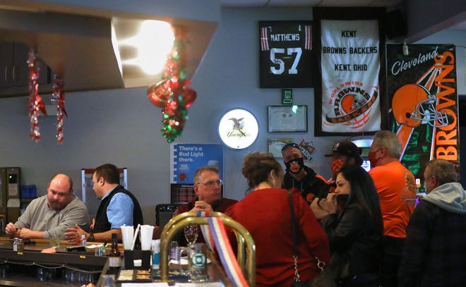 Members of the Kent Browns Backers hang out at American Legion Post 496, Thursday in Kent. Browns fans are optimistic about their team after years of suffering.