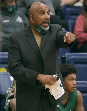 St. Vincent-St. Mary coach Dru Joyce guides the Irish against Cleveland St. Ignatius earlier this season. After having last season halted by COVID-19 during the regional tournament, Joyce and his Irish are focused on a better finish to this season. [Phil Masturzo/ Beacon Journal]