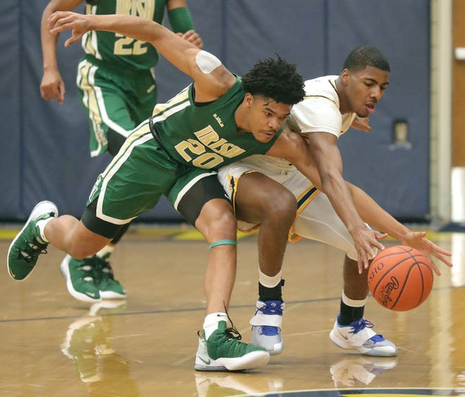 St. Vincent-St. Mary's Ramar Pryor, left, and St. Ignatius' Calvin Little go after a second quarter loose ball on Thursday, Dec. 31, 2020 in Cleveland, Ohio.  The Irish won the game 50-40. [Phil Masturzo/ Beacon Journal]