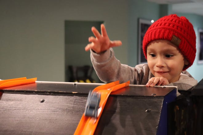 Isen Mireles launches a Hot Wheels car down the ramp at the Don Harrington Discovery Center New Year's Eve Celebration on Thursday.
