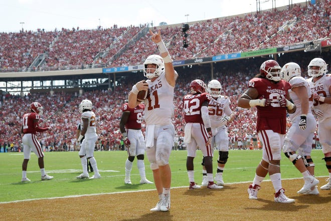 Texas quarterback Sam Ehlinger celebrates after scoring a touchdown against Oklahoma in the Longhorns' 2018 Red River Showdown victory at the Cotton Bowl in Dallas. It was one of the top wins in his Longhorns career; Ehlinger, a senior, is leaving UT  and will enter the NFL draft.
