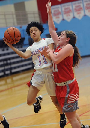 Alliance's Mar'Zae Gantz drives to the basket as Canton South's Alex Brown defends in an Eastern Buckeye Conference game at Alliance High School Wednesday, December 30, 2020.