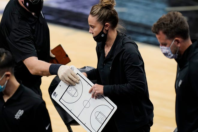 San Antonio Spurs assistant coach Becky Hammon breaks from a huddle during Wednesday's game against the Los Angeles Lakers in San Antonio. Hammon became the first woman to direct an NBA team, taking over the Spurs after coach Gregg Popovich was ejected.