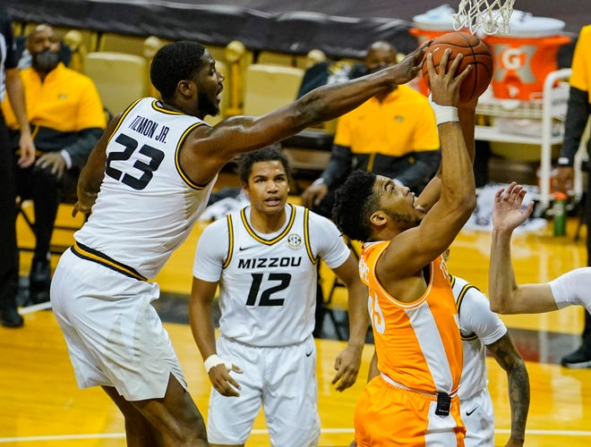 Missouri forward Jeremiah Tilmon (23) blocks a shot by Tennessee forward E.J. Anosike (55) during a game Wednesday at Mizzou Arena.