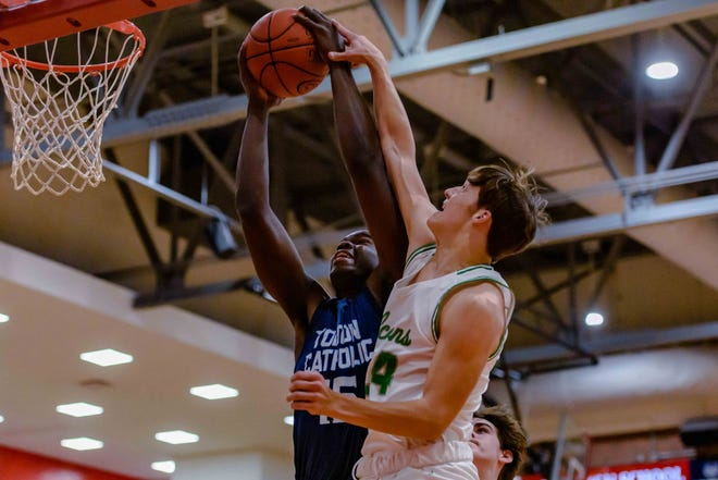 Tolton's Evens Appolon (15) goes up for a rebound and draws a foul from Blair Oaks' Dylan Hair (24) during a game Wednesday at Jefferson City High School.